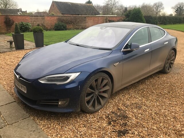 A dirty Tesla ready for cleaning
